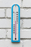 Closeup photo of alcohol thermometer on white wall Royalty Free Stock Image