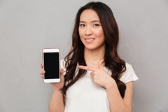 Closeup photo of asian woman in casual t-shirt demonstrating cop Royalty Free Stock Photo
