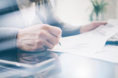 Closeup photo banker working at the table with new business project.  Signs contract and analyze documents. Horizontal Stock Image