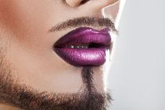 Closeup photo of bearded male lips with makeup Royalty Free Stock Images
