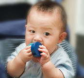 Closeup photo of beautiful cute asian baby expression Stock Image