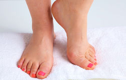 Closeup photo of a beautiful female feet with pedicure.  Royalty Free Stock Photos
