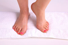 Closeup photo of a beautiful female feet with pedicure.  Stock Photo