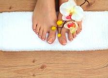 Closeup photo of a beautiful female feet with pedicure.  Stock Image