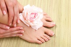 Closeup photo of a beautiful female feet with pedicure Royalty Free Stock Image