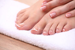 Closeup photo of a beautiful female feet with red Royalty Free Stock Photography