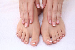 Closeup photo of a beautiful female feet with red Royalty Free Stock Photos