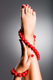 Closeup photo of a beautiful female feet. Stock Image