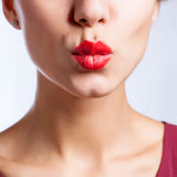 Closeup photo of a beautiful sexy red lips giving kiss Royalty Free Stock Photos