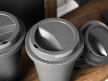 Closeup photo of black coffee cups and chalkboard on bookshelf. 3d render Stock Images