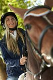 Closeup photo of blonde rider and horse Royalty Free Stock Photography