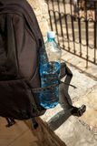 Closeup photo of bottle of water in pocket of backpack stock photo
