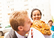 Closeup photo of bride and groom nibbling Stock Photography