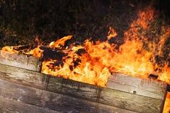 Closeup photo of burning wooden boxes Stock Photo