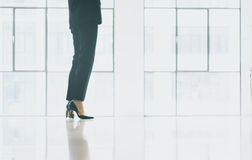 Closeup photo business woman wearing modern suit. Open space loft office. Panoramic windows background. Horizontal Royalty Free Stock Image