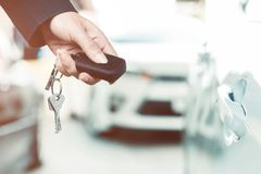Closeup of hands of a businesswoman Using a remote control car key. Closeup photo of a businesswoman hand Using the remote control to open the car door royalty free stock images