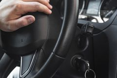 Closeup photo of car interiors.Photos of the car. Steering, keys in the ignition. stock images