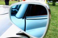 Closeup photo of a car mirror body part Royalty Free Stock Image
