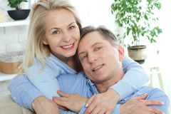 Close up photo of cheerful excited happy happily happy with toothy shining smile blond attractive woman and man, she is Royalty Free Stock Photos
