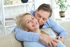 Close up photo of cheerful excited happy happily happy with toothy shining smile blond attractive woman and man, he hugs royalty free stock image