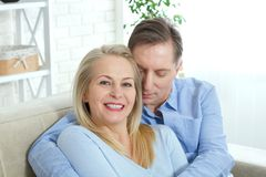 Close up photo of cheerful excited happy happily happy with toothy shining smile blond attractive woman and man, he hugs stock images