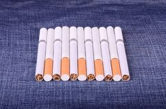 Closeup photo of cigarettes on a jeans background Stock Image
