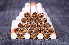 Closeup photo of cigarettes on a jeans background Royalty Free Stock Images
