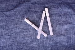 Closeup photo of cigarettes on a jeans background Stock Photo