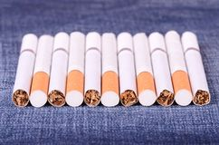 Closeup photo of cigarettes on a jeans background Royalty Free Stock Photos