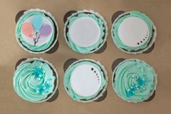 Closeup photo of colorful cupcakes in paper box stock image