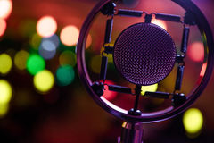 Closeup photo of condenser microphone in bokeh. Closeup photo of condenser microphone in colorful bokeh Stock Photography