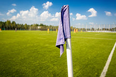 Closeup photo of corner flag on soccer field Royalty Free Stock Image