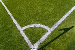 Closeup photo of corner marking on grass soccer field Royalty Free Stock Photography