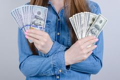 Closeup photo cropped of satisfied happy positive beautiful she her lady student in casual clothes holding many lot pile stack of. Cash in hands isolated grey royalty free stock photography