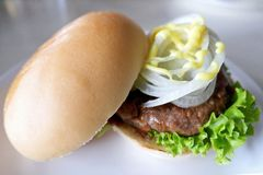 Homemade Burger Buns on a White Plate royalty free stock images