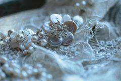 Closeup photo of details, workplace of decorator and creator of wedding imitation jewelry. Closeup macro photo of details, workplace of decorator and creator of royalty free stock photography