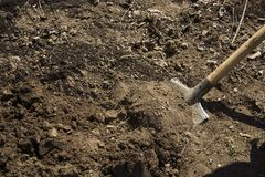 Digging the soil. A closeup photo of digging the soil with a shovel stock image