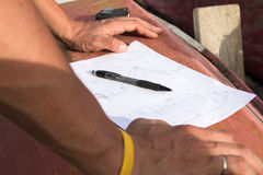 Closeup photo of drawing and carpenter's hands who is going to make design Royalty Free Stock Photos