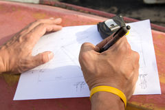Closeup photo of drawing and carpenter's hands who is going to make design Stock Photo