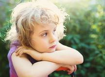Closeup photo of a dreaming little girl outdoor Royalty Free Stock Image