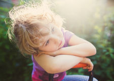 Closeup photo of a dreaming little girl outdoor Stock Image