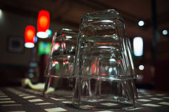 Closeup photo of empty glasses stacked on table Stock Images