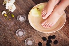 Closeup photo of a female feet at spa salon Stock Images
