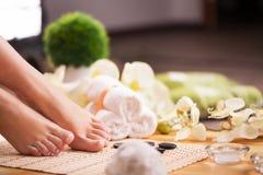 Closeup photo of a female feet at spa salon Royalty Free Stock Image