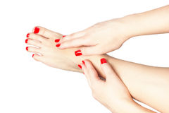 Closeup photo of a female feet at spa salon on pedicure and manicure procedure - Soft focus image isolated royalty free stock image