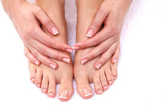 Closeup photo of a female feet at spa salon Stock Photos