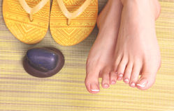 Closeup photo of a female feet at spa salon on Stock Photo