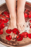 Closeup photo of female feet at spa salon on pedicure procedure. Royalty Free Stock Images