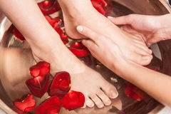 Closeup photo of female feet at spa salon on pedicure procedure. stock images