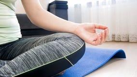 Closeup image of female hand meditating on floor at home. Closeup photo of female hand meditating on floor at home Stock Photography
